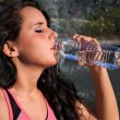 Woman Drinking Water Outside — Stock Photo