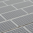 Solar panels on a flat rooftop - Stock Photo