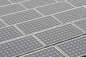 Solar panels on a flat rooftop — Stock Photo