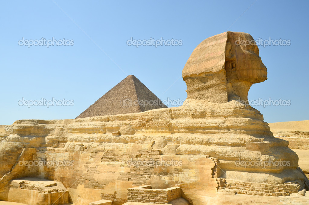 A sphinx is is a mythical creature with, as a minimum, the body of a lion and the head of a human or a cat.  Stock Photo #10951676