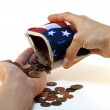 American Flag Wallet with Coins and Hands - Stock Photo