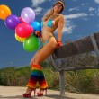 Sexy bikini girl with colorful balloons — Stock Photo