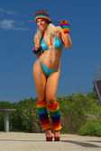 Sexy bikini girl with colorful beanie & legwarmers — Stock Photo