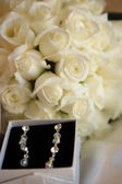 Wedding bouquet and earrings — Stock Photo