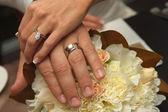Bride and Groom wearing wedding rings — Stock Photo