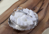 Sugar Cubes in silver bowl — Stock Photo