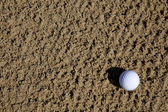 Golfball in sand trap — Photo