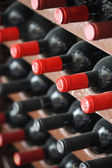Bottles in wine cellar — Stock Photo