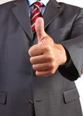Business man gives a thumbs-up sign — Stock Photo