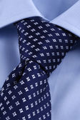 Perfect tie knot on blue business shirt — Stock Photo