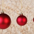 Three red balls on abstract background — Stock Photo