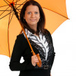 Portrait of happy young female with a orange umbrella isolated o — Stock Photo #11066753