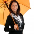 Portrait of happy young female with a orange umbrella isolated o — Stock Photo