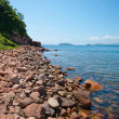 Stock Photo: Red rocky beach