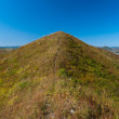 Peak of hill with footpath on it — Stock Photo