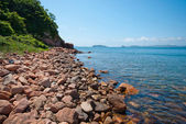Red rocky beach — Stock Photo