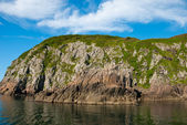 Cliff near the sea — Stock Photo