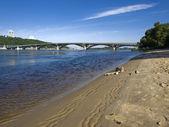 The bridge with a sandy beach — Stock Photo