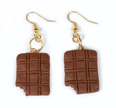 Earrings in the form of chocolates — Stock Photo