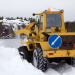 The tractor clears snow from the road blockage — Stock Photo