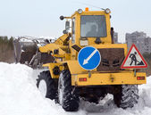 Tractor cleaning snow drifts — Stock Photo
