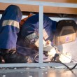 Stock Photo: Welder working in cramped conditions