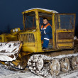 Stock Photo: Tractor clearing snow at night