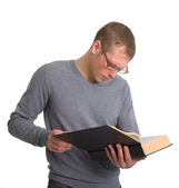A young man reading a great book — Stock Photo