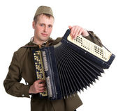 A soldier plays the accordion — Stock Photo