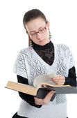 Girl with glasses reading a book — Stock Photo
