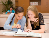 Students reading a book — Stock Photo