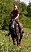 A girl riding a horse at a gallop — Stock Photo