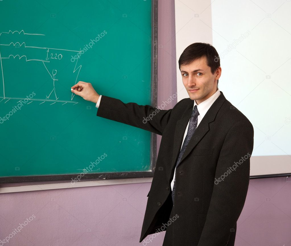 Young scientist giving a lecture on the background of the chalkboard with the scheme. — Stock Photo #11247777