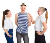 The sailor went ashore and rests with the girls — Stock Photo