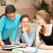 Three girls schoolgirl getting ready for the lesson — Stock Photo