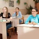 Schoolgirls in the classroom — Stock Photo