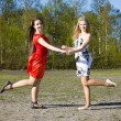 Two girls dancing in the park — Stock Photo #11309796