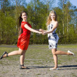 Two girls dancing in the park — Stock Photo