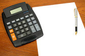 Calculator, paper, pen — Stock Photo
