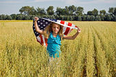 Girl running with flag — Stock Photo
