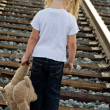Sad child on railroad — Stock Photo