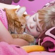 Girl sleeping with cat — Stock Photo #11051390