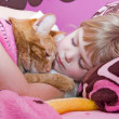 Stock Photo: Girl sleeping with cat