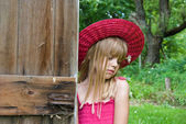 Girl by old door — Stock Photo