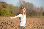 Girl in soybean field — Stock Photo