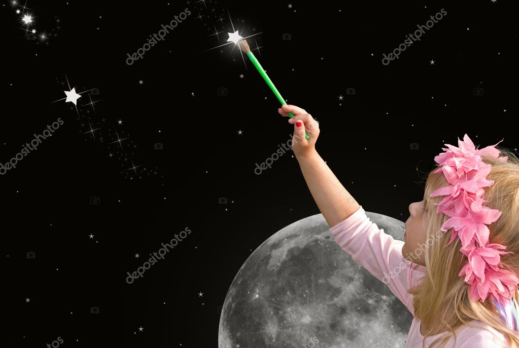Little blond girl painting a star in the night sky.  Stock Photo #11051003