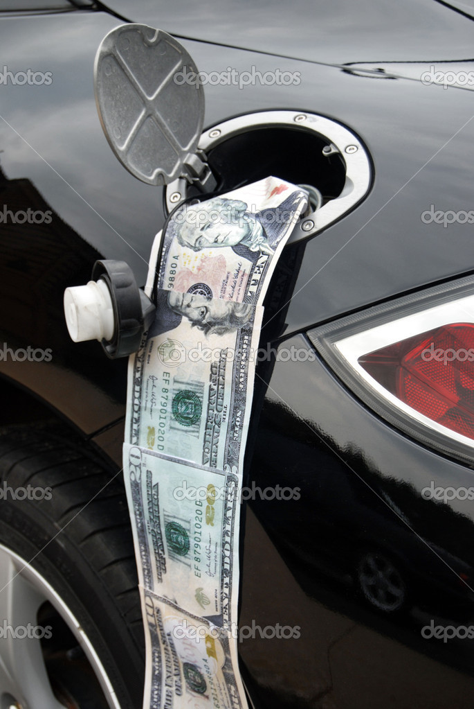 American cash in gas tank of black car.  Foto Stock #11051419