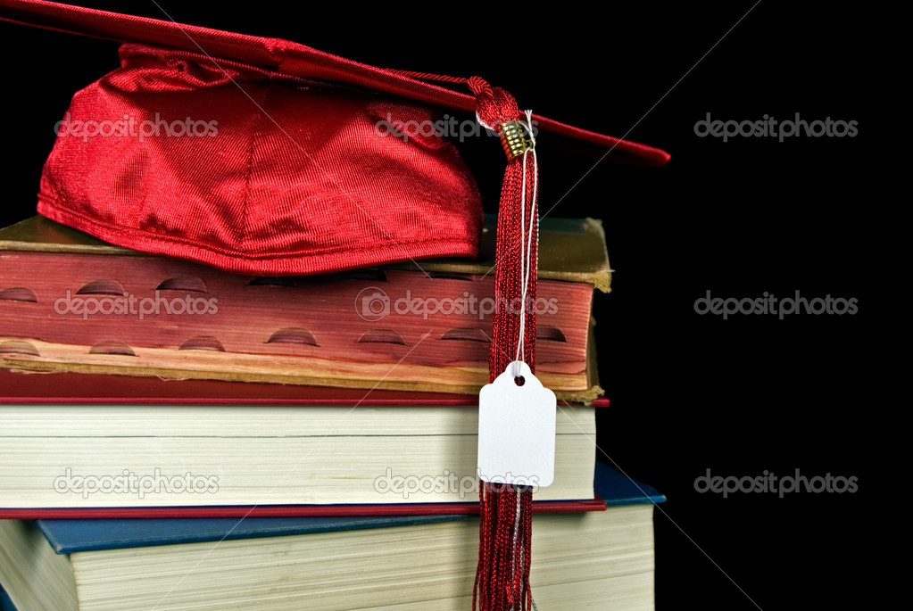 Red graduation cap with price tag on stack of books. — Stock Photo #11051429