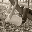Girl hanging from tree — Stock Photo