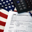 Income tax form on flag - Stock Photo